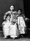 A young Korean woman poses with her daughter wearing traditional hanbok dress, c. 1910.<br/><br/>Hanbok (South Korea) or Chosŏn-ot (North Korea) is the traditional Korean dress. It is often characterized by vibrant colors and simple lines without pockets. Although the term literally means 'Korean clothing', hanbok today often refers specifically to hanbok of Joseon Dynasty and is worn as semi-formal or formal wear during traditional festivals and celebrations.<br/><br/>The modern hanbok does not exactly follow the actual style as worn in Joseon dynasty since it underwent some major changes during the 20th century.